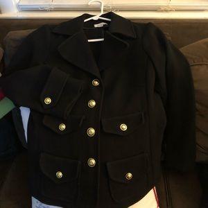 Black blazer with gold button detail.